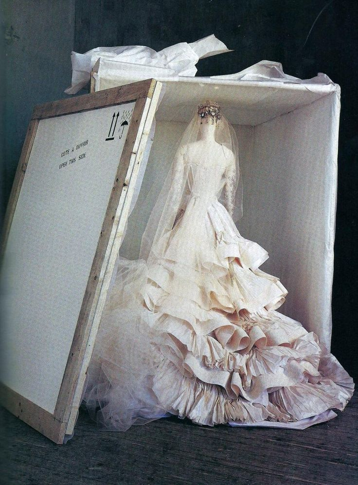 """""""When shipped abroad, a Christian Lacroix wedding dress travels upright in a cloth case, each layer resting in a bed of tissue. Such extraordinary care and attention to detail is the foundation of the couture."""" So Neat"""
