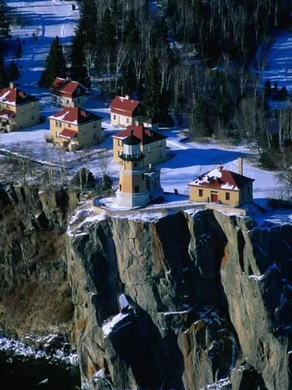 Lighthouse and Houses Under Blanket of Snow on Top of Cliff at Split Rock, Minnesota, USA ( looks like a Christmas village)
