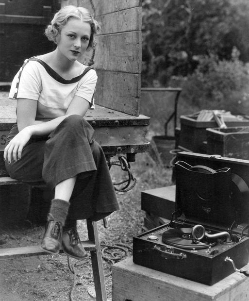 """Sally Eilers takes a break filming """"Walls of Gold"""" to listen to a record; 1933"""