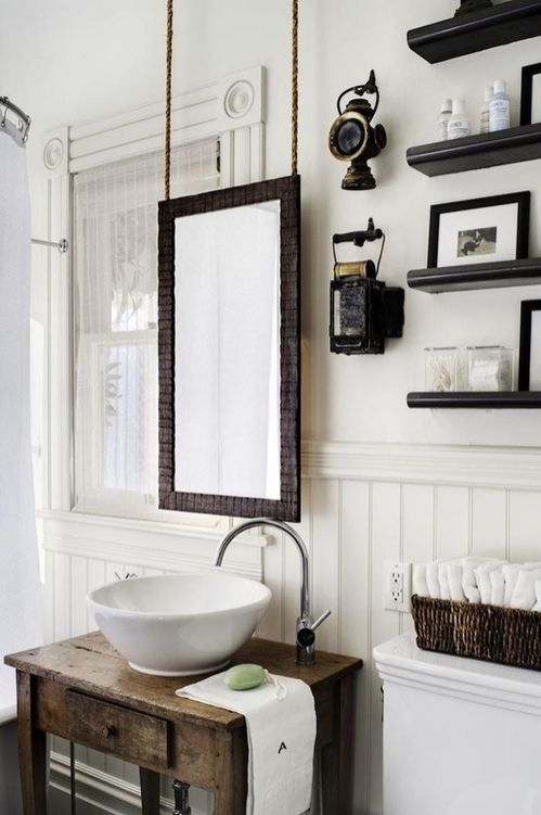 Bathroom. Rustic. I like the hanging mirror option. Very unique.