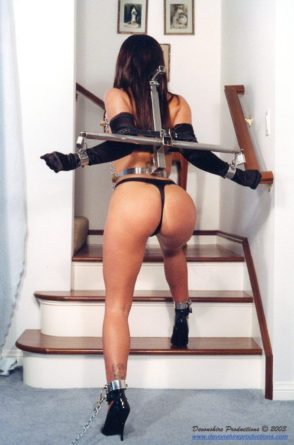 image Slave in metal frame and scolds bridle