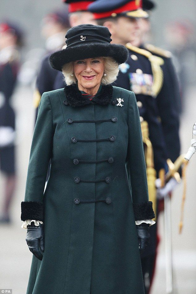 The Duchess of Cornwall wrapped up in a green wool coat as she represented the Queen at The Sovereign's Parade at the Royal Military Academy Sandhurst on Friday morning