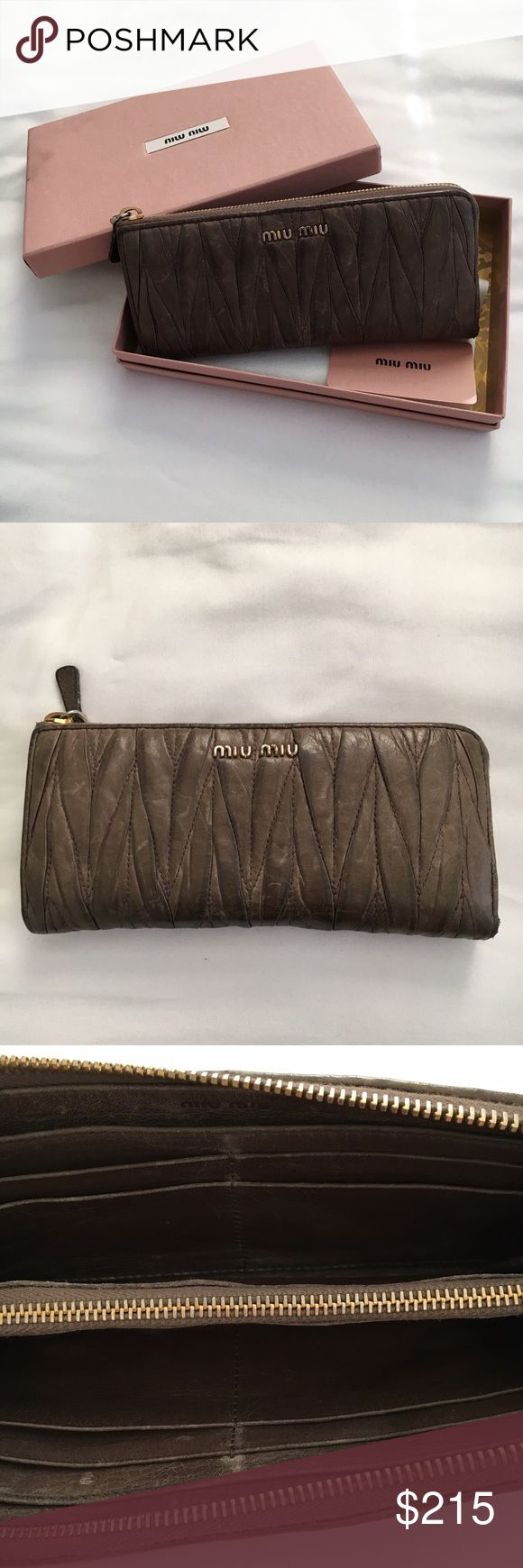Miu Miu Wallet Miu Miu Wallet. Authentic, comes with tag and box. Contenitori Piatti color Cammeo in collection Matelasse. In used condition, signs of wear, discoloration on leather, inside fabric, and on hardware. Miu Miu Bags Wallets