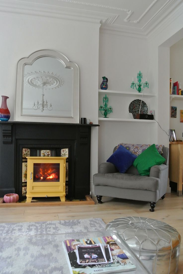 Chesney's electric stove in yellow. - From Wendron Stoves Cornwall. This is in a customers house in London.