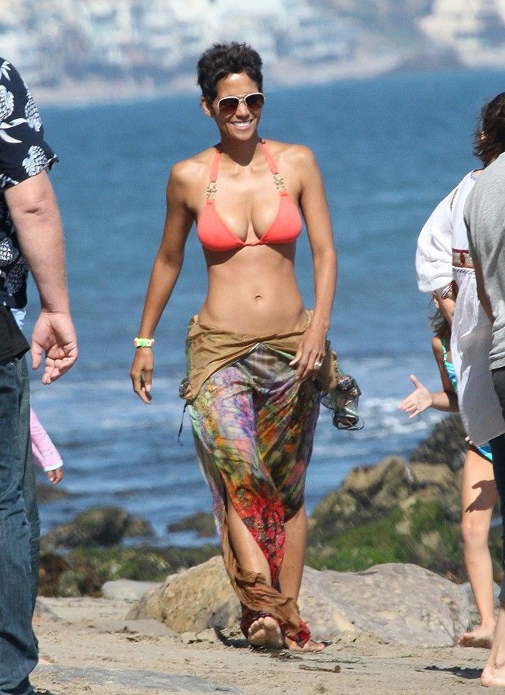 Sometimes covering up is sexier than going skimpy! Halle Berry's sarong allows her to show off her amazing body while still leaving a little to the imagination.