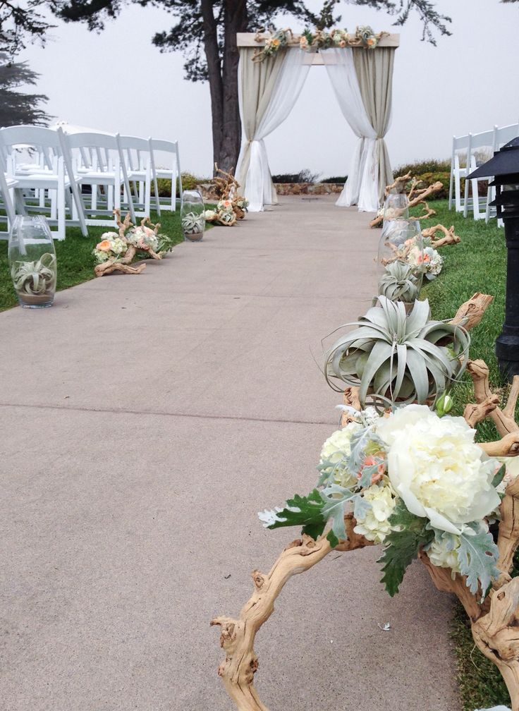 free wedding venues in california%0A Beach wedding at seascape resort in Aptos CA  Driftwood aisle  with Peonies  and succulents
