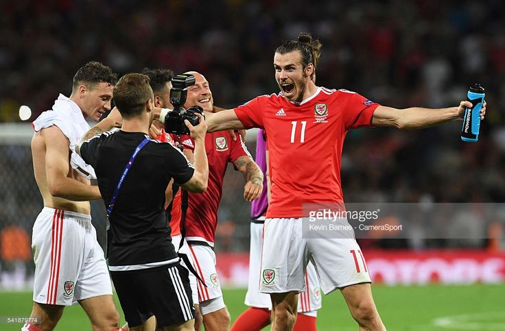 Wales's Gareth Bale celebrates his sides win by posing for a photo after the UEFA Euro 2016 Group B match between Russia v Wales at Stadium de Toulouse on June 20 in Toulouse, France.