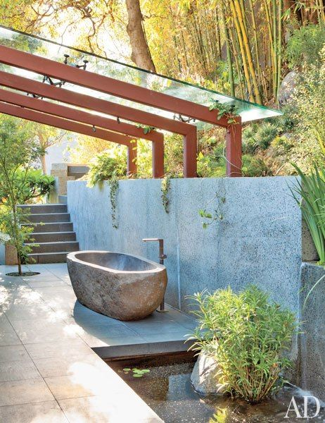 A basalt tub with Dornbracht fittings anchors the outdoor area off the master suite at John Legend and Chrissy Teigen's Hollywood Hills Home