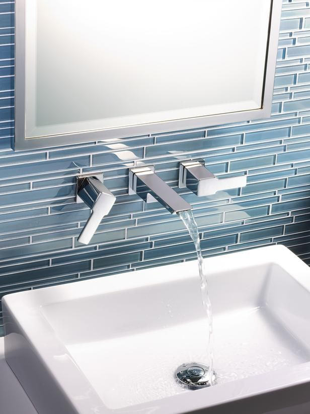 Bold Glass Tile Backsplash | HGTVRemodels.com    I like the variation in size and thickness but would want a different color
