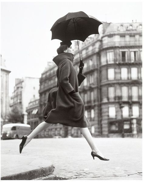 'Carmen (Homage to Munkacsi), coat by Cardin', Place Francois-Premier, Paris, 1957 - Avedon, Richard