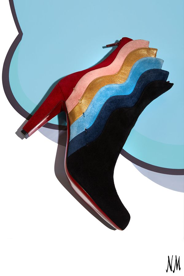 Slip into suede waves by Christian Louboutin. Pair with a metallic mini dress for your next weekend look.