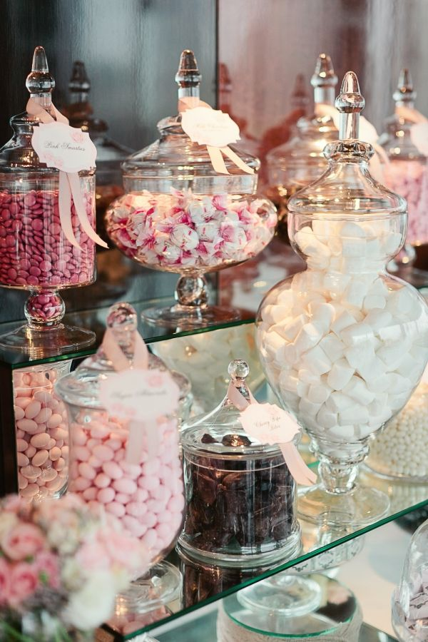 pink candies in apothecary jars for candy bar wedding favors