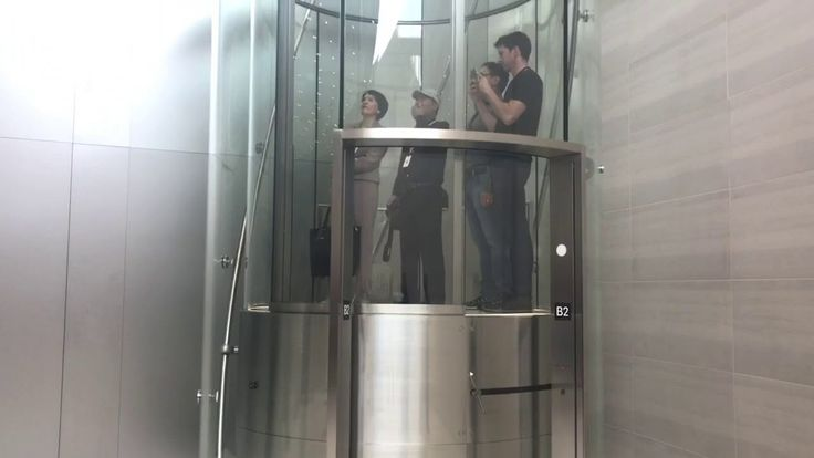 Spinning cylinder shaped elevator at Apple's new SpaceShip HQ - YouTube