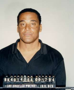 AL COWLINGS Cowlings was one of O.J. Simpson's closest friends and he is notorious for driving Simpson in the white Bronco during the dramatic low speed car chase. Shown here is his mug shot after being arrested for suspicion of aiding a fugitive. Al Cowlings - Ron Galella/WireImage