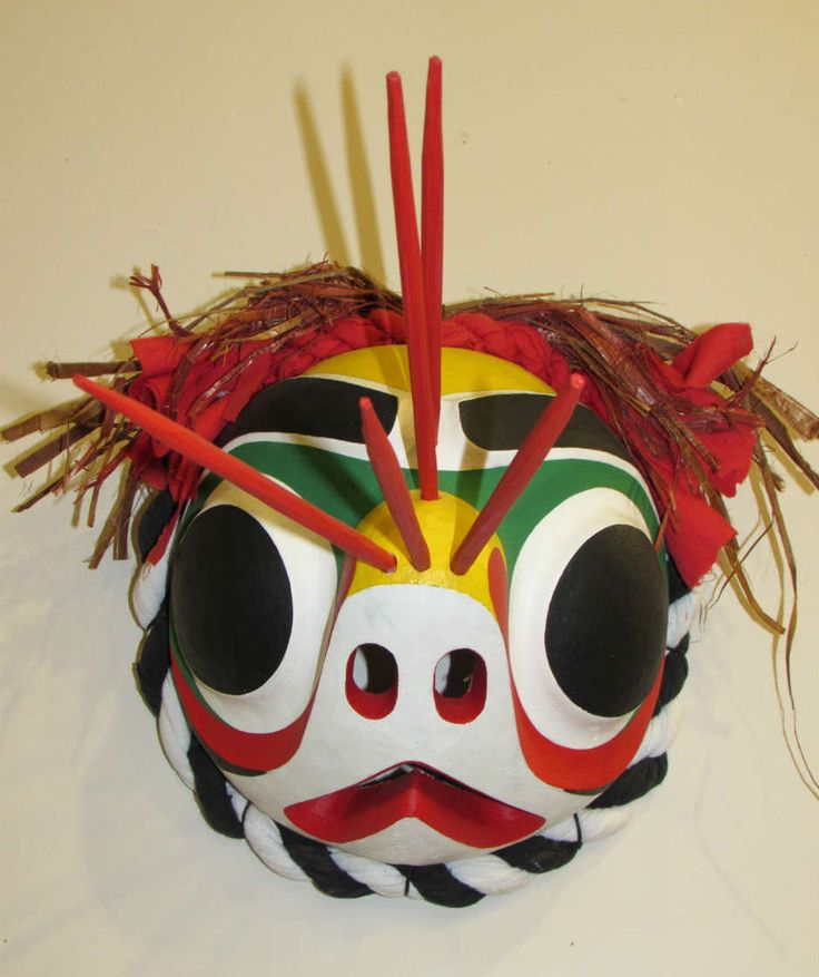 The Bumble Bee dance is for the children and youth of the community during the potlatch. They come out with their masks in a swarm to lighten the mood of the otherwise more serious event.  This mask was created by #Northwest #Coast #FirstNations artist Wayne Alfred. Wayne Alfred is Kwakwaka'wakw, and is from Alert Bay, BC. This mask was carved out of cedar, painted with acrylic paint and adorned with fabric, cedar bark and cedar stingers.