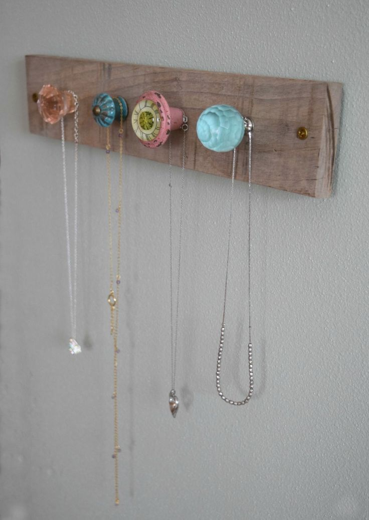 A simple DIY jewelry wall display is added in this girl bedroom to make the space a little cuter and a lot more functional creatively adding organization.