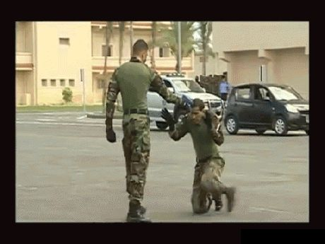 SCARY SELF DEFENSE TECHNIQUE - WHEN THOUGHT CAPTURED & SUBDUED ON KNEES ON THE GROUND - SOLDIER QUICKLY KICKS LEGS OUT FROM UNDER SURPRISED MAN - WOW - AMAZING ACTION GIF!