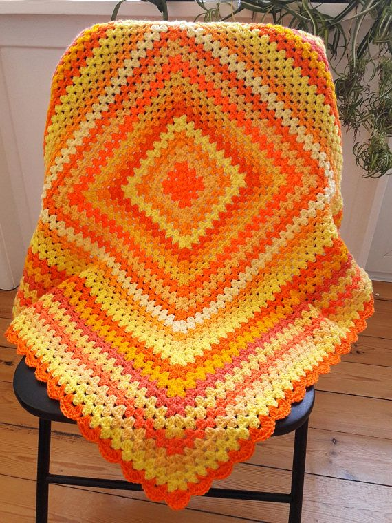 This yellow crochet baby blanket is the perfect size for a stroller or pram and just right to keep your special baby warm and cozy.