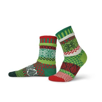 Solmate Socks Winter Series Mistletoe is a bright fun sock to wear during the Holidays and after. The colors are Forest Green, Emerald Green, Apple Green, Cherry Red and Snow White. If you can't find real Mistletoe hang this sock at the door.
