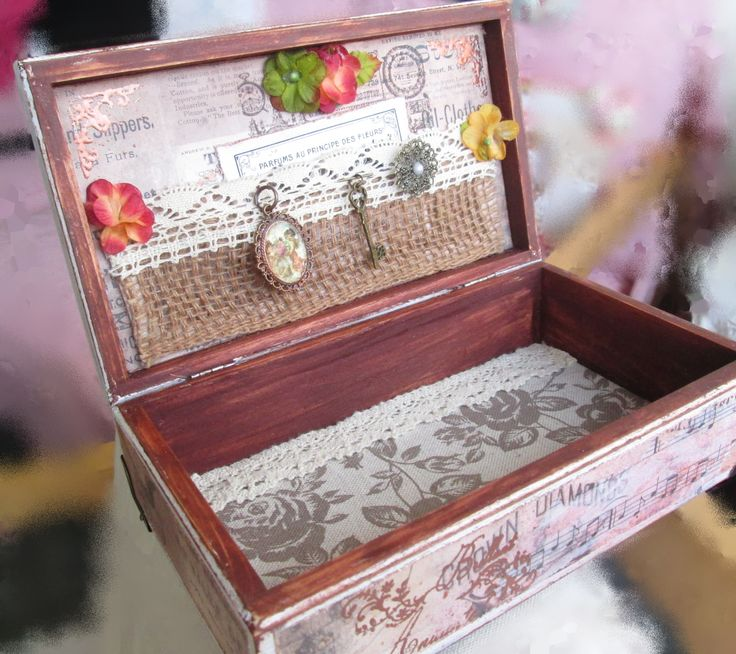 Small wooden box with patina, decorated with scrapbook paper, metal and wooden ornaments ...inside fabric