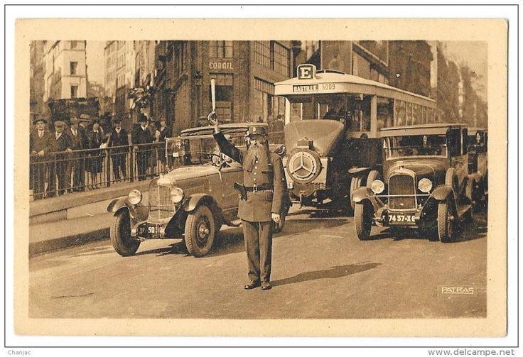 http://www.delcampe.fr/page/item/id,371346726,var,cpa-PARIS-Les-Grands-Boulevards--LAgent-de-Police-a-La-Porte-Saint-Denis-Voiture-Autobus-5009-BastilleN-7,language,F.html