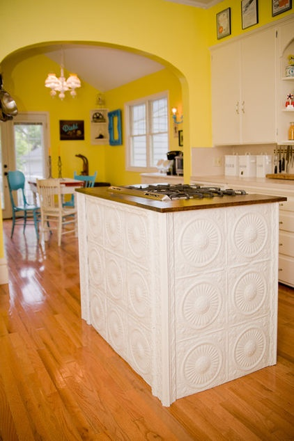 Kitchen Island covered in vintage tin ceiling tiles.