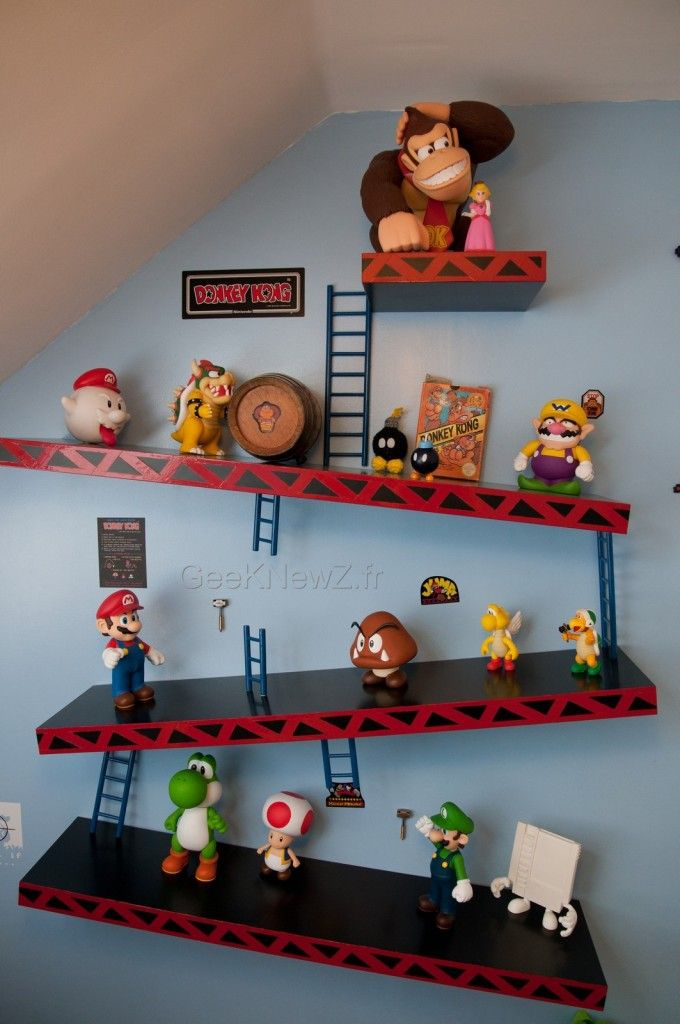Excellent idea for oldest child's bedroom! He can use this to display all his Nintendo figures. It would look awesome with his Zelda posters and gamer theme.  I plan on making this buy purchasing black floating shelves and cutting red vinyl.