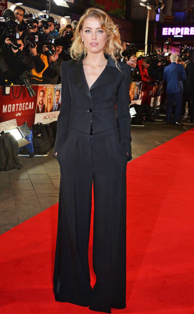 Amber Heard from Celebs in Pantsuits  Johnny Depp's main squeeze sported a chic, all-black pantsuit featuring a fitted blazer and oversize trousers to the U.K. premiere of Mortdecai in London.