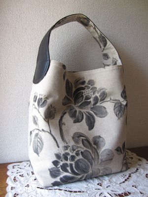 cute fabric handbag/tote ... with leather handle/strap lined underneath with fabric