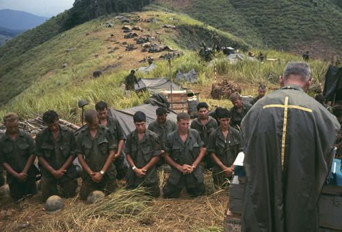 Soldiers pray with an Army chaplain, Vietnam