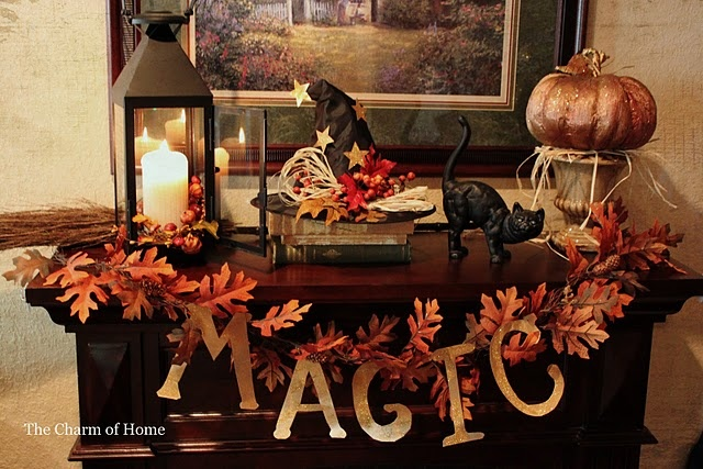 Magical fall table scape. Love that the wizard hat looks like it was just tossed there, and anything with black cats (we have 2) wins my approval!