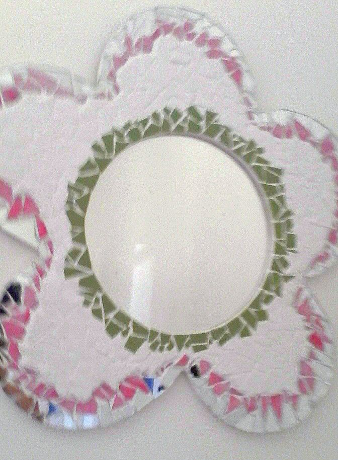 This is a flower shaped mirror mosaic that did in pink white pistachio green and mirror tile pieces for a friends daughters birthday .... I am loving how it turned out but more importantly I would love your feedback....please comment.... Thankyou.... AOX