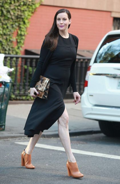 Liv Tyler's casual style out in West Village New York City in May 2014....