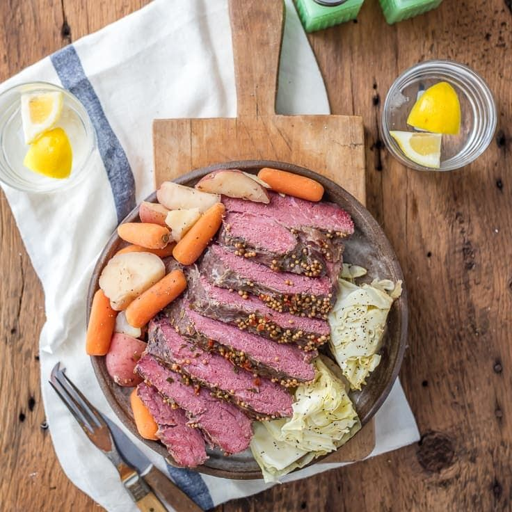 Traditional Slow Cooker Corned Beef and Cabbage is a MUST MAKE St. Patrick's Day recipe! Celebrate with Corned Beef, Cabbage, Potatoes, and Carrots!