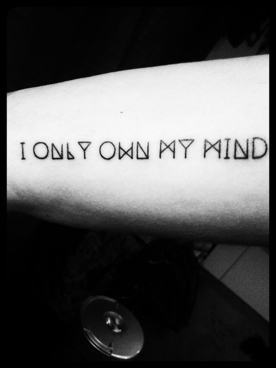 Cool and simple inner arm tattoo. Pearl Jam lyric to I am mine. #tattoo #pearl jam #black ink #lyric #geometric font