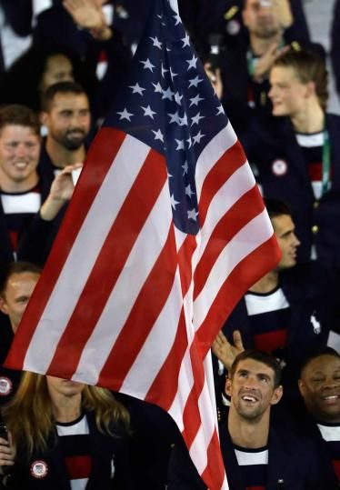 Michael Phelps carries the U.S. flag into the Opening Ceremony