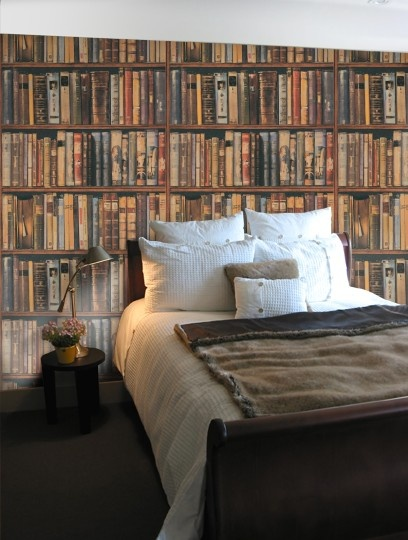 Andrew Martin wallpaper designed to resemble shelves filled with old leather-bound books