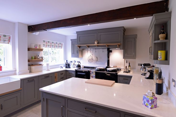 A hand painted Hallwood Furniture kitchen with Okite Quartz work surfaces and Oak details.