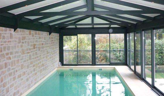 Les 25 meilleures id es de la cat gorie piscines int rieur for Veranda piscine interieure