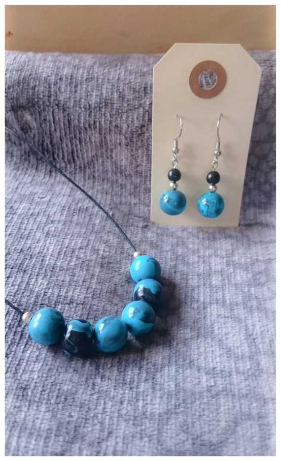 Polymer clay turquoise and black marbled bead necklace and earrings by Little Clay Place.