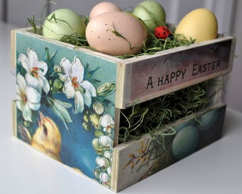 A little Michael's wooden crate, some scrapbook paper, some raffia or egg basket grass and you have a charming arrangement. 41 FASHIONABLE IDEAS TO  DECORATE YOUR HOME FOR EASTER