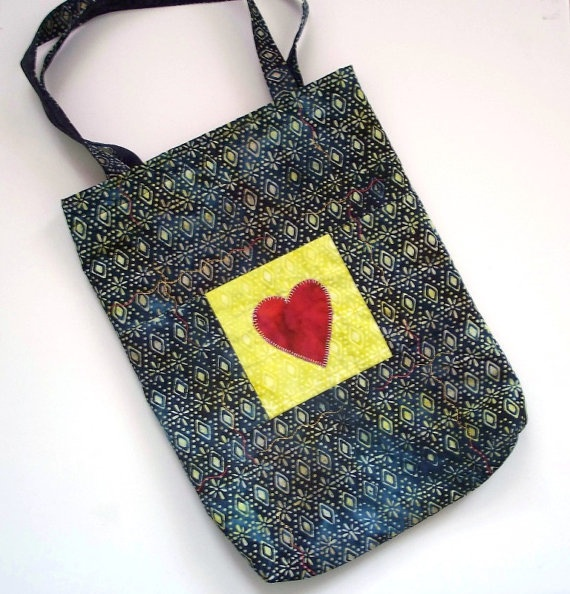 Navy blue meets acid lemon lime with a hit of red to pull it all together. Sustainable cotton tote by Julie Clark.