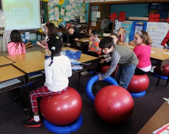 Central Elementary School in East Bridgewater started a pilot program allowing students to sit on stability balls instead of chairs in class, a strategy shown to improve posture, engagement and allow for some bouncing fun.