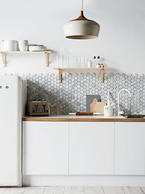 My favourite honeycomb tiles lovely scandi kitchen with smeg fridge carrara marble hexagon mosaic tiles and a gorgeous coco flip pendant light