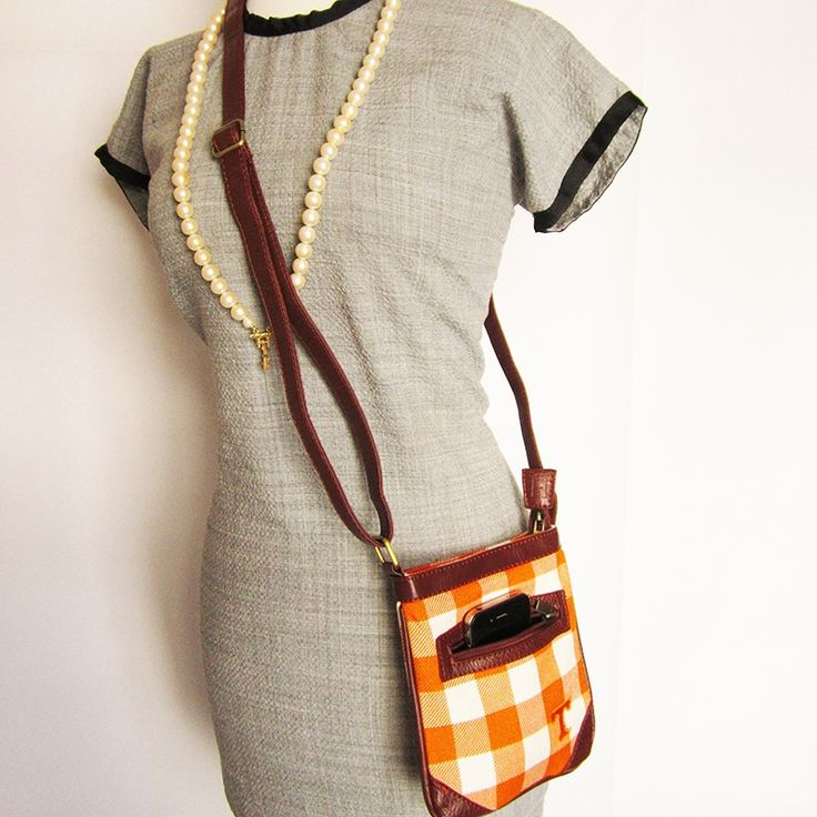 Ticket Bag - University of Tennessee $34.99 Tartan and leather adjustable strap purse. Wear it cross body and on gameday or any day. Fits a phone and wallet and other small items. This Product Makes a Great Holiday Gift for any Tennessee Vols fan!