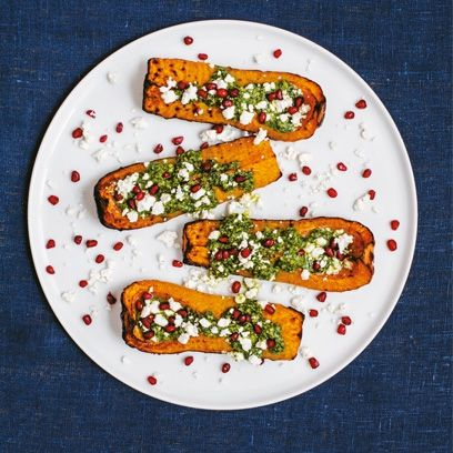 Sabrina Ghayour's butternut squash stuffed with feta and pomegranate. For the full recipe, click the picture or see www.redonline.co.uk