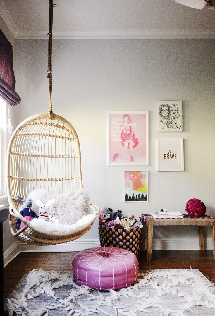 Hanging chair in living room with small gallery wall - this would be so cute in a little one's room!