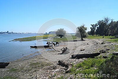 Landscape from the Danube delta with boats and horse with cart, Romania