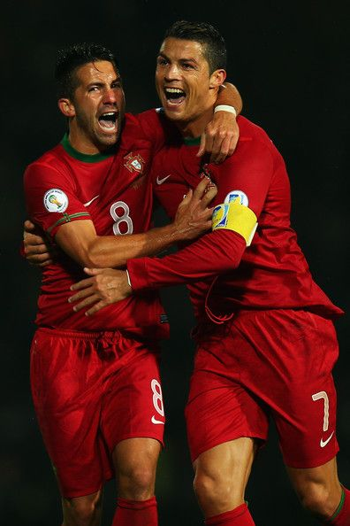 Cristiano Ronaldo Photos Photos - Cristiano Ronaldo of Portugal celebrates scoring with team mate Joao Periera during the FIFA 2014 World Cup Qualifying Group F match between Northern Ireland and Portugal at Windsor Park on September 6, 2013 in Belfast, Northern Ireland. - Northern Ireland v Portugal