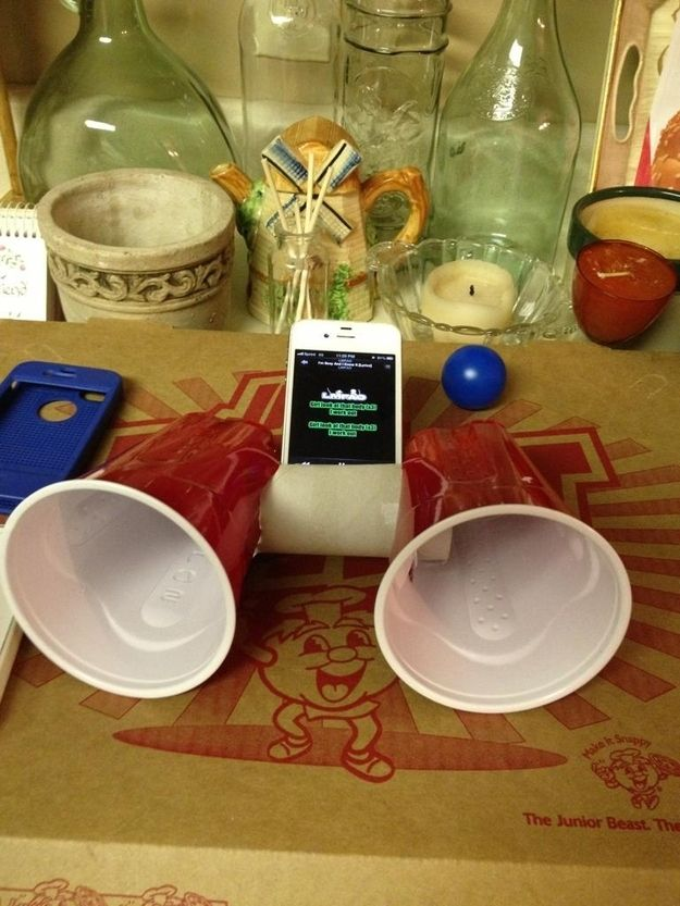Everyone's heard of the toilet-paper-roll-iPhone-speaker, but adding Solo cups can really amplify the sound. | 28 Low-Tech Hacks For Your High-Tech Gadgets